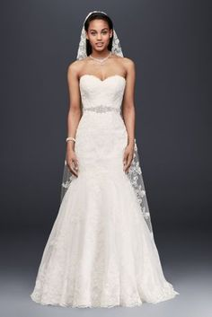 With a feminine sweetheart neckline and a beaded sash, this figure-flattering, scalloped-hem lace wedding dress makes a timelessly chic statement.   David\'s Bridal Collection Polyester Chapel train&n