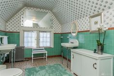 1910 Capitol Hill Tudor. Like the tiles and the two sinks on opposite walls.