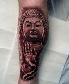If you want less decorations and more on realistic tattoo designs, then this one is right for you. It looks exactly like those Buddha status you see on Buddhist temples.