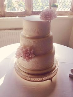 3 tier ivory wedding cake, Madagascan vanilla sponge, handmade edible lace and sugar roses :-)