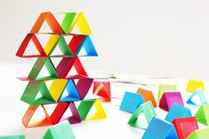 Just a simple strip of card made into a triangle and voila! Paper building blocks.