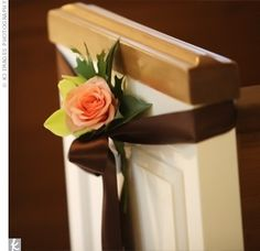 pew decor - with baby's breath....rose.... and  cornflower blue ribbon instead