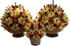 Fresh fruit bouquets: some good arrangement pictures with info on used fruits at this ugly website: http://fruitmagic.magix.net/website#Fruit%20Bouquet%20Main%20Page