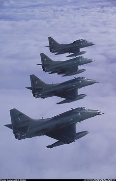 A-4 Skyhawk formation. Did ya notice the two seater ??