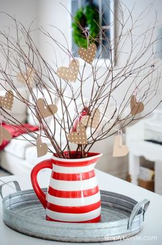 Looking for a centerpiece? Grab a red vase or pitcher and have fun with sticks from your yard – too cute! Valentine Home Decor Ideas on Frugal Coupon Living.