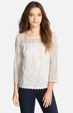The perfect white lace top. Could be cute for work with a sweater or jacket, or paired with jeans for a more casual look. On sale now at Nordstrom.
