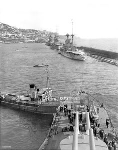 16 in sisters HMSs Nelson and Rodney together with 15 in Queen Elizabeth class battleship HMS Warspite (nearest camera) alongside the Mole, Gibraltar.  The latter has undergone her first but not her second modernisation, dating this picture to the late 1920s / early 1930s.