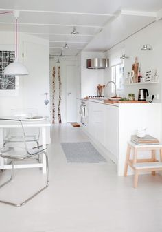 Narrow.  Small.  White.  Low ceiling.  Cozy.  LOVELY.      Scandinavian styled camping caravan