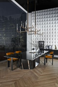 """Platium / Table with 15mm black painted glass top, in the bright or satin version. Large bevel of 4 cms on two sides. Sahara Noir marble base. """"Supermirror"""" bright stainless steel bottom plate. [Gallotti&Radice]"""