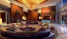 A grand entrance with high ceiling, the perfect lighting and the smooth bow lined furniture make an excellent, modern lounge area Exterior Design, Interior And Exterior, Hotel Lounge, Lobby Design, Modern Lounge, Condos For Sale, Lounge Areas, Creative Home, Contemporary Design
