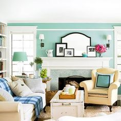 love the teal blue walls, yellow and blue accents and great mantel details.