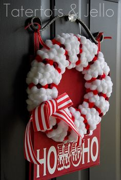 Love this Candycane pom pom wreath.  Would it be bad if I make a new wreath a year.....and rotate Christmas wreaths weekly? :)