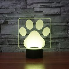 Product Overview The Dog Paw Print 3D LED Illusion Lamp is a combination of art and technology that creates an optical 3D illusion and plays tricks on the eyes. From afar, you will see the design, but