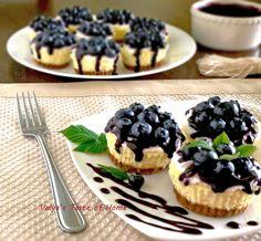 Mini Blueberry Cheesecakes http://valyastasteofhome.com/mini-blueberry-cheesecake #miniblueberrycheesecake #dessert #minicheesecakes