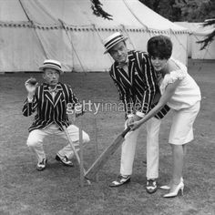 uly 1961: Bing Crosby, Bob Hope (1903 - 2003) and Joan Collins playing a game of cricket on the set of 'The Road To Hong Kong' on the first day of filming at Shepperton Studios. (Photo by Frank Martin/BIPs/Getty Images)