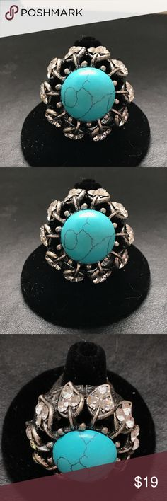 Beautiful Turquoise colored and Crystal ring This is a beautiful stretch ring that has a turquoise colored stone and crystals! It's very beautiful!! Brand new ! Never Worn! Not Designer Brand Jewelry Rings