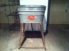Would make a Great Planter or to hold Ice for beverages!  VINTAGE GALVANIZED TUB ON STAND WITH WHEELS WHEELING #62 Ebay ID - brio60robert