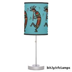 This fun lamp features several Kokopelli figures, painted in the style of Pacific Northwest art, playing flutes and dancing in front of a turquoise background. https://www.zazzle.com/dancing_flute_playing_kokopelli_figures_table_lamp-256786169509340328?rf=238083504576446517&tc=20170302_pint_SSOZ #homedecor #lighting #music #StudioDalio #Zazzle