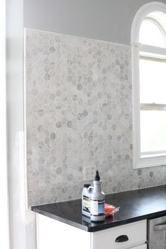 DIY tutorial on backsplash tiling. I like the granite hexagons