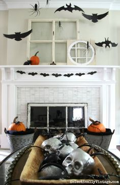 Love this black and white Halloween mantel and that big dough bowl of skulls! eclecticallyvintage.com