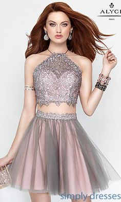 Shop lace-up two-piece homecoming dresses at Simply Dresses. Open-back short semi-formal party dresses with beaded lace and layered tulle skirts.