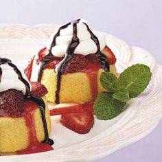 Strawberry Chocolate Shortcakes Recipe -This fluffy, creamy strawberry shortcake is adapted from my sister's recipe. The drizzle of chocolate sauce on top is a great addition to this sweet, delightful dessert. —Agnes Ward, Stratford, Ontario
