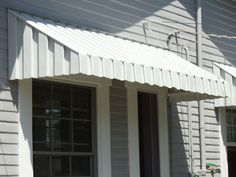 Could scalloped lower edges be cut off the existing awnings? This is a much cleaner, more pleasing look.