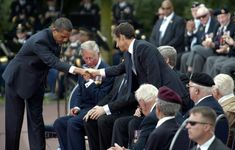 U.S. President Barack Obama  shook hands with France's President Nicolas Sarkozy beside Britain's Prince Charles (2nd L) after Obama delivered a speech at the Colleville-sur-Mer cemetery during a ceremony to mark the 65th anniversary of the D-Day landings in Normandy, June 6, 2009.