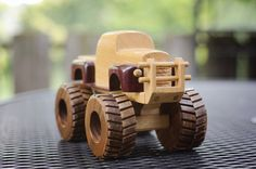 Wooden Monster Truck toy made out of purpleheart wood