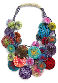 WANT this colorful necklace!! Would look amazing with a simple black dress or a turtleneck.