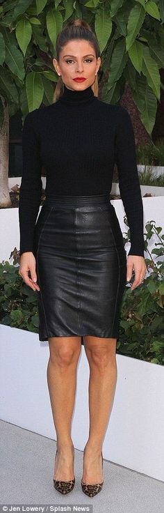 Fall outfit: The former WWE Diva donned a simple black knit turtleneck by Naked Wardrobe, while she opted for a chic leather pencil skirt from Reiss Fashion that ended just above the knee, and served to showcase her impressively toned legs