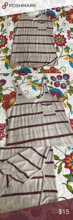 🤙🏼UO Striped Scoopneck Tank with Pocket🤙🏼 Scoopneck in front and back!! Stripes are multi-colored: deep purple, pinks, and orange with taupe all over. This top runs a bit large, so I find it to be roomy and comfy! Would fit fine on a medium or large also. Super soft cotton and pocket detail. The best parts are the side slit openings on either side, these allow for lots of movement and cool partial tucking in! Make an offer, price negotiable or bundle up!! ✌🏼 Staring at Stars Tops Tank…