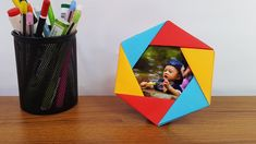Dear DIY Paper Crafts Lover, Enjoy a beautiful Photo Frame making instruction step by step with Colors Paper. It's an unique concept by me. Already I have published some awesome DIY Photo Frame making instruction on my channel so visit my channel. Paper Photo Frame Diy, Diy Photo Frame Cardboard, Cardboard Frames, Paper Crafts Origami, Easy Paper Crafts, Diy Origami, Diy Paper, Origami Gifts, Diy Crafts