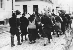 Warsaw, Poland, Women carrying spades on their way to forced labor.