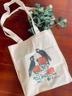 The glorious black cockatoo can now go everywhere with you, on this adorable calico tote bag. A pair of black cockatoo perch upon bright red banksia in this adorable design by Mokoh Designs.A sturdy cotton calico tote with an gusset and long . Australian Gifts, Cockatoo, Recycled Materials, Reusable Tote Bags, Handle, Bright, Pocket, Shoulder, Fit