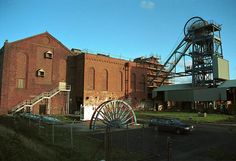 On the site of the former Haig Pit in Whitehaven, which closed in 1986, the winding engine house and headgear are being restored to their former glory and is now open as the Haig Colliery Mining Museum.
