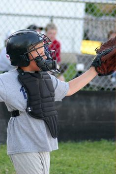 Playing catcher can be a difficult task for a young player.
