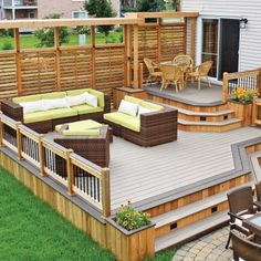 small deck, raised, with low paved area in lieu of a deck