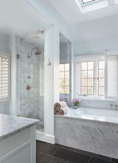 Splendor in the Bath. White bathroom with dark floors. Architect Stephen Muse…