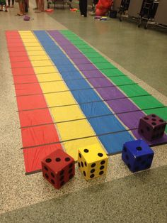 Dice game 2 to 5 players First player that gets to the end of their lane wins 5 tickets. You must roll the same number of spaces you have left to win at the end of your lane. All players that don't win get 1 ticket.