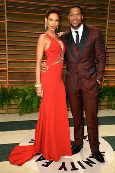 TV personalities Nicole Murphy (L) and Michael Strahan attends the 2014 Vanity Fair Oscar Party hosted by Graydon Carter on March 2, 2014 in West Hollywood, California.