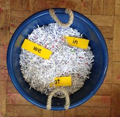 Week Lucky dip with oral vocabulary / high frequency words. The children have a list of words each that they have to find in the shredded paper. Literacy skills / games for kindergarten Phonics Games, Phonics Reading, Jolly Phonics, Teaching Phonics, Phonics Activities, Literacy Skills, Word Games, Literacy Activities, Teaching Reading