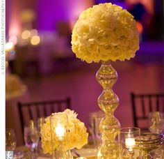 While almost half of the 19 tables featured centerpieces with orchids, the others had mixed balls of white roses in modern metallic holders.