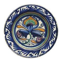 An Italian maiolica footed dish ~ late 15th /early-16th century ~ Central Italy ~ Probably Faenza ~ Painted in the 'Gothic' style, the center with a flower, possibly an iris, the border with stylized angled grasses and blossoms