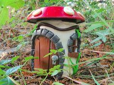 DIY fairy house uses: glass jar, clay, and solar light