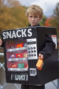 Using a number of cardboard boxes, lots of spray paint, nine slinkies, a piece of plexi-glass and some candy, I made my son a Vending Machine costume ...