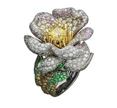 Giampiero Bodino Primavera white and yellow gold ring with white, grey, yellow and cognac diamonds, pink sapphires, emeralds and a central yellow diamond. Image: Laziz Hamani