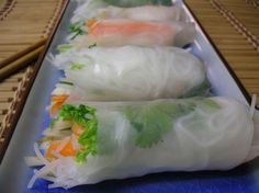 My friend, Lan, who is Vietnamese, showed me how to make these delicious and healthy spring rolls. These are served cold and are NOT fried. They do require some skill to roll - unless youve made these before, you may want to have extra rice papers on hand in case you tear some! It is crucial to use only fresh herbs etc. in this dish, however you can use any cooked meat or fish combo that you prefer. Vegetarians may omit meat altogether. The prep time given is how long it should take - but…