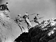 SPAIN. Cordoba front. Early 1936. Loyalist militiamen jumping over a gully.