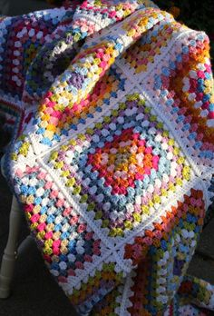 What a beautiful crocheted blanket!  Perfect to snuggle up to on a cool fall day.